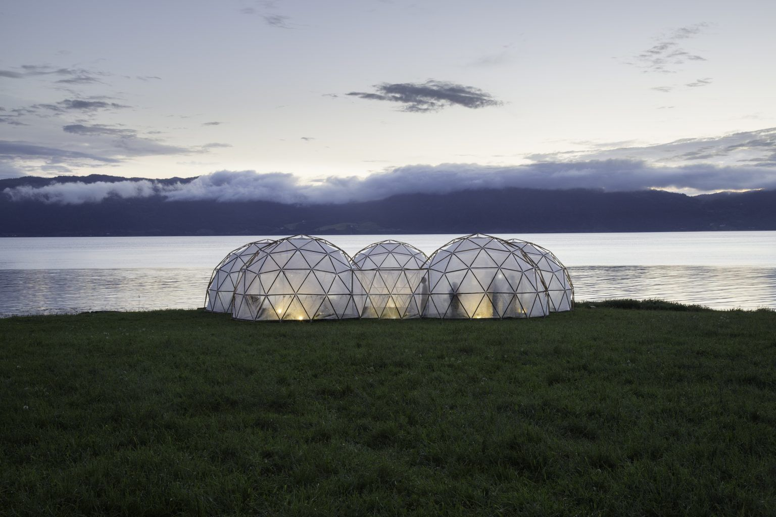 A photo of the connected pollution pods with the sea and sky behind them