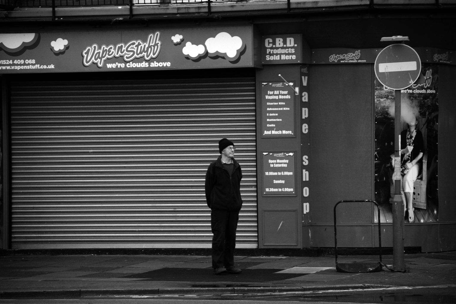 Man outside Shuttered Shop